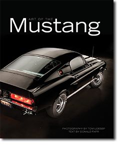 Front cover of Art of the Mustang book with shiny black Ford Mustang top view